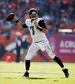 Oct 13, 2013; Denver, CO, USA; Jacksonville Jaguars quarterback Chad Henne (7) throws the ball during the first half against the Denver Broncos at Sports Authority Field at Mile High. Mandatory Credit: Chris Humphreys-USA TODAY Sports
