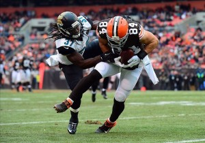 Dec 1, 2013; Cleveland, OH, USA; Cleveland Browns tight end Jordan Cameron (84) catches a pass while being defended by Jacksonville Jaguars strong safety Johnathan Cyprien (37) in the second quarter at FirstEnergy Stadium. Mandatory Credit: Andrew Weber-USA TODAY Sports