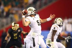 Jan 1, 2014; Glendale, AZ, USA; Central Florida Knights quarterback Blake Bortles (5) against the Baylor Bears during the Fiesta Bowl at University of Phoenix Stadium. Central Florida defeated Baylor 52-42. Mandatory Credit: Mark J. Rebilas-USA TODAY Sports