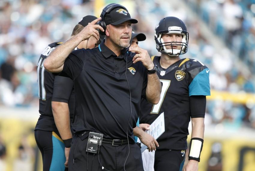 Dec 22, 2013; Jacksonville, FL, USA; Jacksonville Jaguars head coach Gus Bradley and quarterback Chad Henne (7) lok up against the Tennessee Titans during the first half at EverBank Field. Mandatory Credit: Kim Klement-USA TODAY Sports