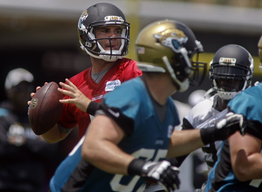 Jun 17, 2014; Jacksonville, FL, USA; Jacksonville Jaguars quarterback Blake Bortles (5) looks for a receiver during the first day of minicamp at Florida Blue Health and Wellness Practice Fields. Mandatory Credit: Phil Sears-USA TODAY Sports