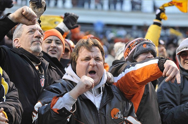 Jan 1, 2012; Cleveland, OH, USA; Cleveland Browns fans cheer in the dawg pound during a game against the Pittsburgh Steelers at Cleveland Browns Stadium. The Steelers won 13-9. (David Richard-US PRESSWIRE)