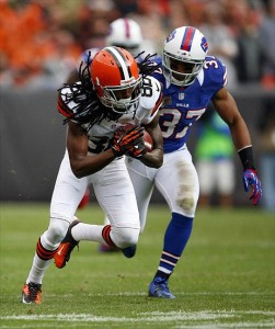 Sep 23, 2012; Cleveland, OH, USA; Cleveland Browns wide receiver Travis Benjamin (80) makes a catch and runs down the field against Buffalo Bills strong safety George Wilson (37) during the second quarter at Cleveland Browns Stadium. Buffalo defeats the Browns 24-14. (Raj Mehta-US PRESSWIRE)