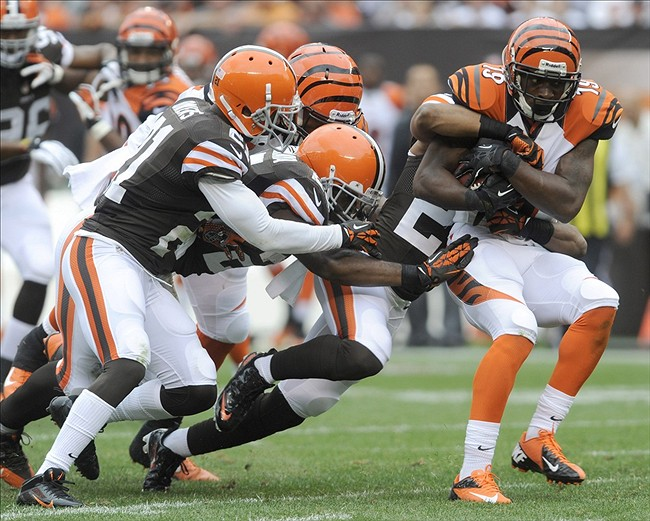 Sep 29, 2013; Cleveland, OH, USA; Cincinnati Bengals wide receiver Brandon Tate (19) is taken down by the Cleveland Browns defense during the fourth quarter at FirstEnergy Stadium. Mandatory Credit: The Browns beat the Bengals 17-6. Ken Blaze-USA TODAY Sports