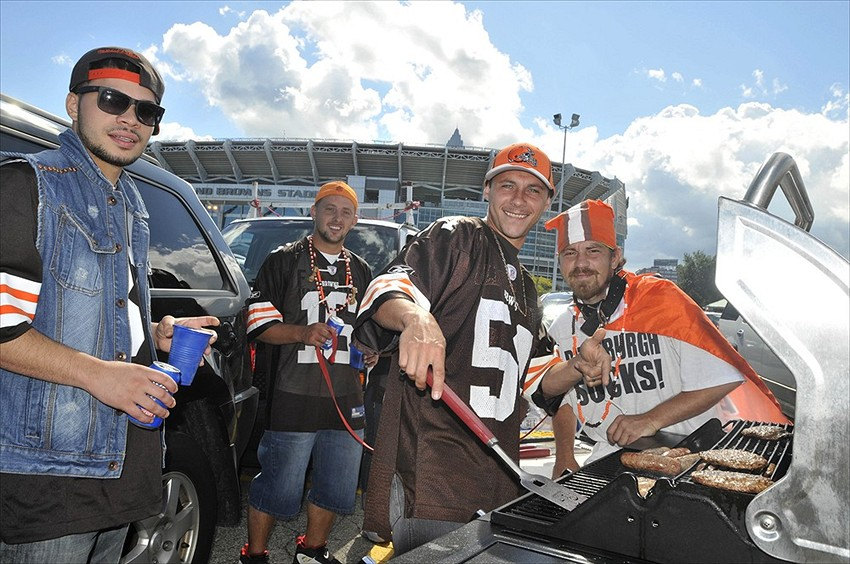 Sep 9, 2012; Cleveland, OH, USA; Cleveland fans T.J. Velez (left), D.J. Fletcher (second from left), Bo Lehman (third from left) grill hamburgers in the parking lot before a game between the Philadelphia Eagles and the Cleveland Browns at Cleveland Browns Stadium. Mandatory Credit: David Richard-USA TODAY Sports