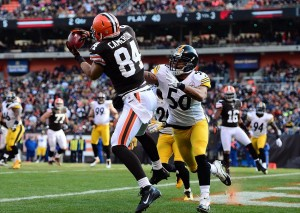 Nov 25, 2012; Cleveland, OH, USA; Cleveland Browns tight end Jordan Cameron (84) catches a pass in the end zone for a touchdown while being defended by Pittsburgh Steelers inside linebacker Larry Foote (50) in the second quarter at Cleveland Browns Stadium. Mandatory Credit: Andrew Weber-USA TODAY Sports