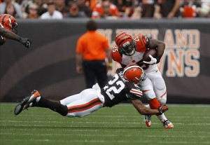 Sep 29, 2013; Cleveland, OH, USA; Cincinnati Bengals running back Giovani Bernard (25) gets tackled by Cleveland Browns cornerback Buster Skrine (22) during the second quarter at FirstEnergy Stadium. Mandatory Credit: Raj Mehta-USA TODAY Sports