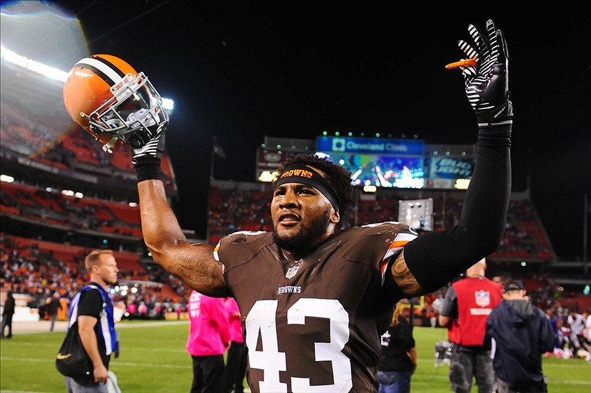 Oct 3, 2013; Cleveland, OH, USA; Cleveland Browns strong safety T.J. Ward (43) celebrates after defeating the Buffalo Bills 37-24 at FirstEnergy Stadium. Mandatory Credit: Andrew Weber-USA TODAY Sports