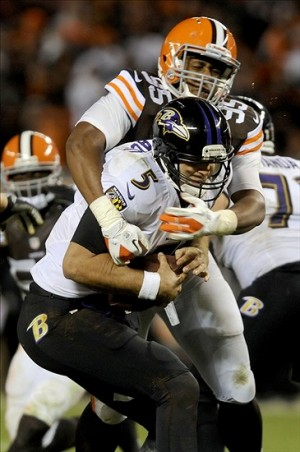 Nov 3, 2013; Cleveland, OH, USA; Cleveland Browns defensive end Armonty Bryant (95) sacks Baltimore Ravens quarterback Joe Flacco (5) during the fourth quarter at FirstEnergy Stadium. The play was nullified due to a Browns penalty. The Browns won the game over the Ravens 24-18. Mandatory Credit: Ken Blaze-USA TODAY Sports