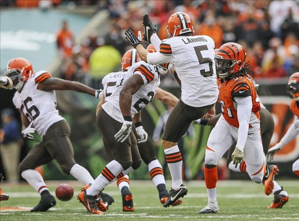 Nov 17, 2013; Cincinnati, OH, USA; Cincinnati Bengals linebacker Jayson DiManche (51) blocks the punt of Cleveland Browns punter Spencer Lanning (5) during the first half at Paul Brown Stadium. Mandatory Credit: Kevin Jairaj-USA TODAY Sports
