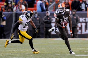 Nov 24, 2013; Cleveland, OH, USA; Cleveland Browns wide receiver Josh Gordon (12) runs the ball after a catch as Pittsburgh Steelers strong safety Will Allen (20) defends during the fourth quarter at FirstEnergy Stadium. The Steelers beat the Browns 27-11. Mandatory Credit: Ken Blaze-USA TODAY Sports