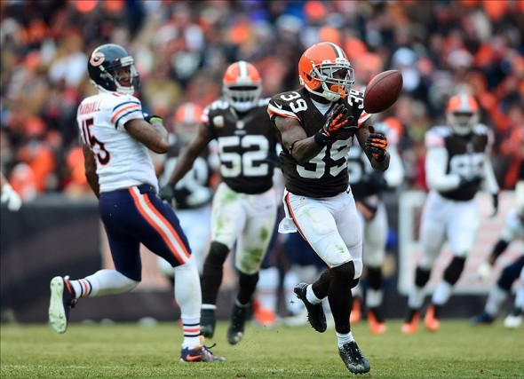 Dec 15, 2013; Cleveland, OH, USA; Cleveland Browns free safety Tashaun Gipson (39) intercepts a pass during the second quarter against the Chicago Bears at FirstEnergy Stadium. Mandatory Credit: Andrew Weber-USA TODAY Sports