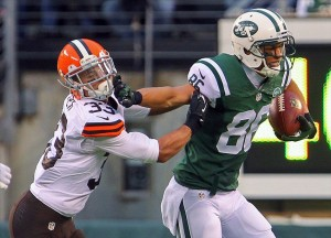 Dec 22, 2013; East Rutherford, NJ, USA; New York Jets wide receiver David Nelson (86) breaks a tackle by Cleveland Browns cornerback Jordan Poyer (33) during the second half at MetLife Stadium. The Jets defeated the Browns 24-13. Mandatory Credit: Ed Mulholland-USA TODAY Sports
