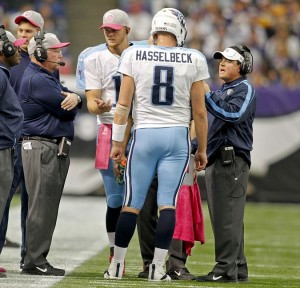 Oct 7, 2012; Minneapolis, MN, USA; Tennessee Titans quarterbacks coach Dowell Loggains (right) talks with quarterback Matt Hasselbeck (8) as quarterback Rusty Smith (11) and offensive coordinator Chris Palmer listens during a break in the game with the Minnesota Vikings at the Metrodome. The Vikings win 30-7. Mandatory Credit: Bruce Kluckhohn-USA TODAY Sports