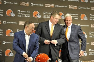 Jan 11, 2013; Berea, OH, USA; Cleveland Browns head coach Rob Chudzinski (center) walks off the stage after his introductory press conference with owner Jimmy Haslam III (right) and chief executive officer Joe Banner at the team