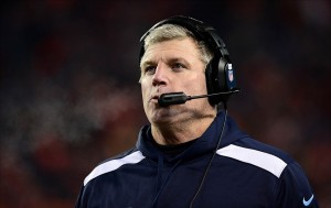 Dec 8, 2013; Denver, CO, USA; Tennessee Titans head coach Mike Munchak on his sidelines late in the fourth quarter against the Denver Broncos at Sports Authority Field at Mile High. The Broncos defeated the Titans 51-28. Mandatory Credit: Ron Chenoy-USA TODAY Sports