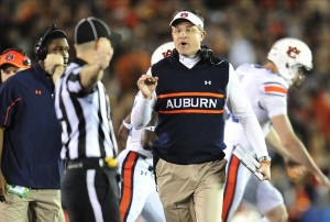 Jan 6, 2014; Pasadena, CA, USA; Auburn Tigers head coach Gus Malzahn speaks to an official during the first half of the 2014 BCS National Championship game against the Florida State Seminoles at the Rose Bowl. Mandatory Credit: Gary A. Vasquez-USA TODAY Sports