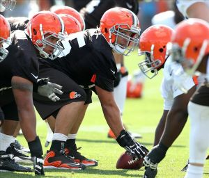 Jul 26, 2013; Berea, OH, USA; Cleveland Browns offensive linesman Alex Mack (55) checks the defense before the snap during training camp at the Cleveland Browns Training Facility. Mandatory Credit: Ron Schwane-USA TODAY Sports