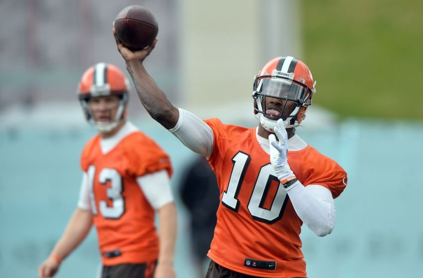 Jun 7, 2016; Berea, OH, USA; Cleveland Browns quarterback Robert Griffin III (10) throws a pass as quarterback Josh McCown (13) watches during minicamp at the Cleveland Browns training facility. Mandatory Credit: Ken Blaze-USA TODAY Sports