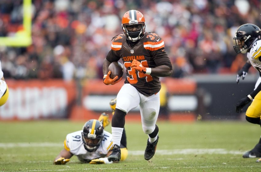 Jan 3, 2016; Cleveland, OH, USA; Cleveland Browns running back Isaiah Crowell (34) runs past a tackle fromPittsburgh Steelers defensive end Stephon Tuitt (91) during the first quarter at FirstEnergy Stadium. The Steelers defeated the Browns 28-12. Mandatory Credit: Scott R. Galvin-USA TODAY Sports