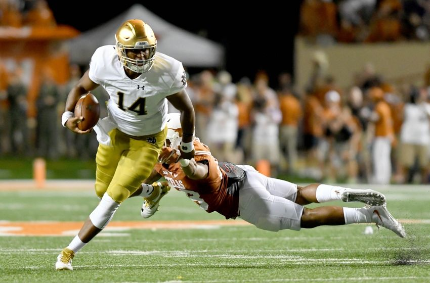 Sep 4, 2016; Austin, TX, USA; Notre Dame Fighting Irish quarterback DeShone Kizer (14) runs for a touchdown as Texas Longhorns safety Kevin Vaccaro (18) defends in the third quarter at Darrell K. Royal-Texas Memorial Stadium. Texas won 50-47 in double overtime. Mandatory Credit: Matt Cashore-USA TODAY Sports