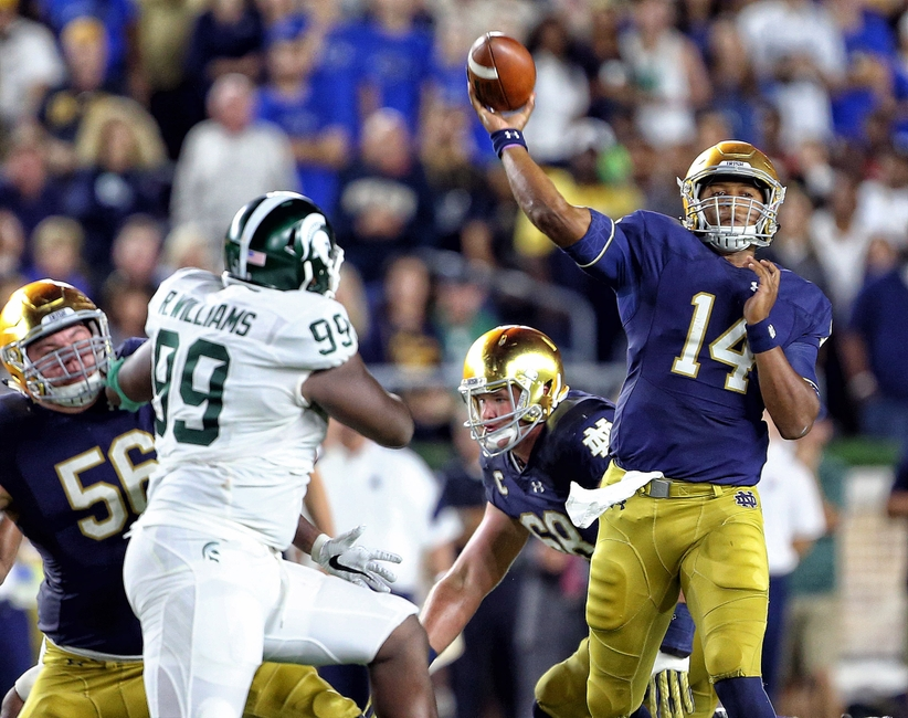 Sep 17, 2016; South Bend, IN, USA; Notre Dame Fighting Irish quarterback DeShone Kizer (14) throws the ball over Michigan State Spartans defensive lineman Raequan Williams (99) during the second half a game at Notre Dame Stadium. Mandatory Credit: Mike Carter-USA TODAY Sports
