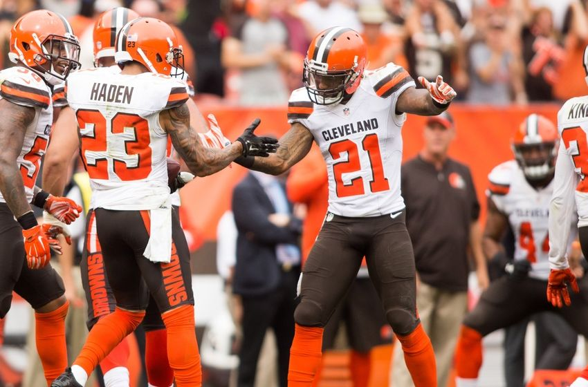 Sep 18, 2016; Cleveland, OH, USA; Cleveland Browns cornerback Joe Haden (23) celebrates with Cleveland Browns cornerback Jamar Taylor (21) after a third quarter interception against the Baltimore Ravens at FirstEnergy Stadium. The Ravens defeated the Browns 25-20. Mandatory Credit: Scott R. Galvin-USA TODAY Sports