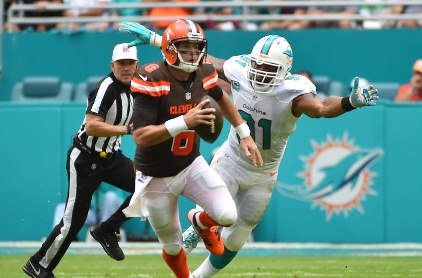 Sep 25, 2016; Miami Gardens, FL, USA; Cleveland Browns quarterback Cody Kessler (6) scrambles under pressure from Miami Dolphins defensive end Cameron Wake (91) during the first half at Hard Rock Stadium. Mandatory Credit: Jasen Vinlove-USA TODAY Sports