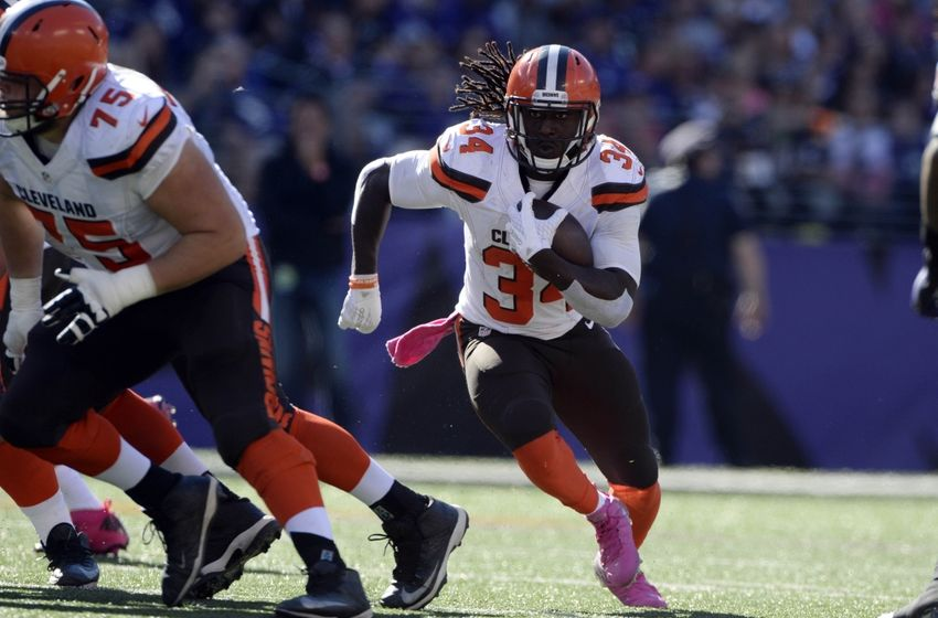 Oct 11, 2015; Baltimore, MD, USA; Cleveland Browns running back Isaiah Crowell (34) runs through the line during the third quarter against the Baltimore Ravens at M&T Bank Stadium. Mandatory Credit: Tommy Gilligan-USA TODAY Sports