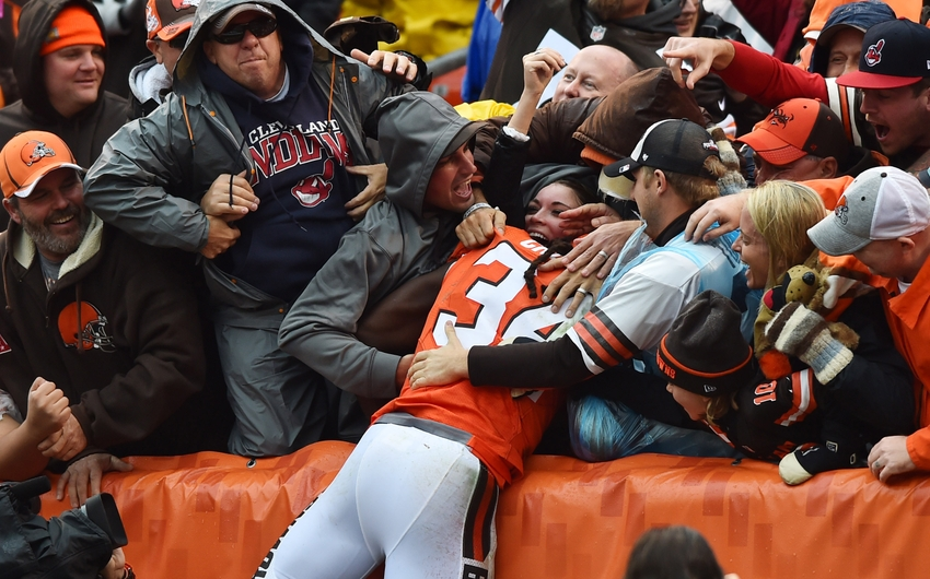 Oct 30, 2016; Cleveland, OH, USA; Cleveland Browns running back Isaiah Crowell (34) jumps into the Dawg Pound after scoring a touchdown during the second quarter against the New York Jets at FirstEnergy Stadium. Mandatory Credit: Ken Blaze-USA TODAY Sports