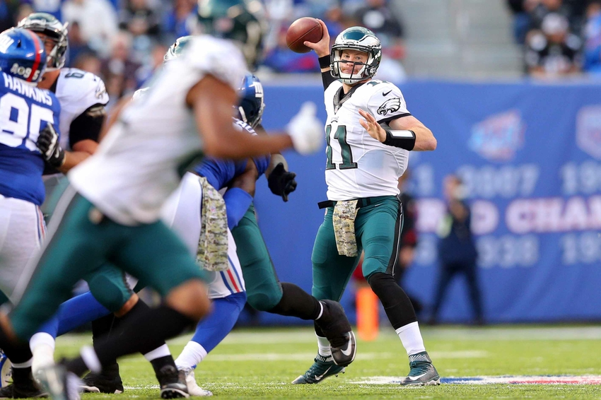Nov 6, 2016; East Rutherford, NJ, USA; Philadelphia Eagles quarterback Carson Wentz (11) throws a pass against the New York Giants during the second quarter at MetLife Stadium. Mandatory Credit: Brad Penner-USA TODAY Sports