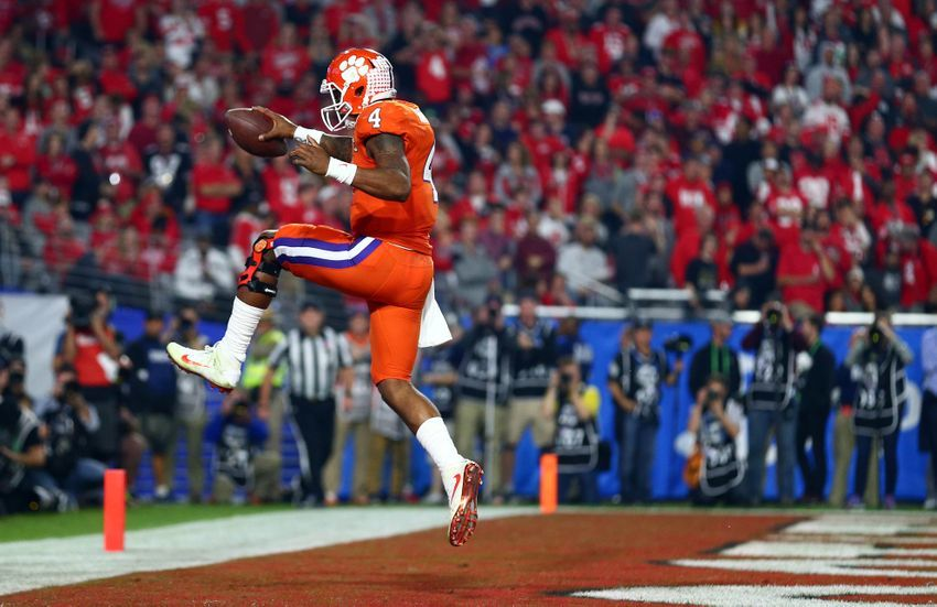 December 31, 2016; Glendale, AZ, USA; Clemson Tigers quarterback Deshaun Watson (4) runs the ball in for a touchdown against the Ohio State Buckeyes during the second half of the the 2016 CFP semifinal at University of Phoenix Stadium. Mandatory Credit: Mark J. Rebilas-USA TODAY Sports
