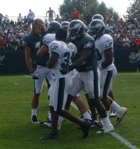 Eagles WR Riley Cooper and CB Ellis Hobbs are separated by teammates after a brief fight.