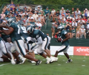 Philadelphia's first string offensive line blocks for running back Mike Bell.