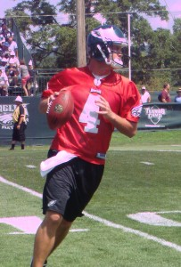 Kevin Kolb warms up before practice.