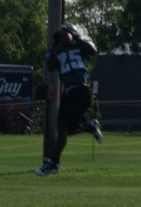Eagles running back LeSean McCoy makes a leaping catch as linebacker Simoni Lawrence looks on.