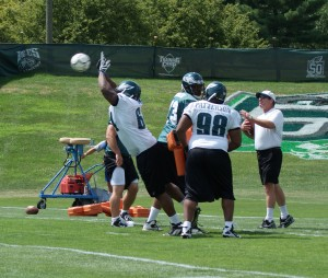 Defensive tackle Jeff Owens blocks a soccer ball as Special Teams Coordinator Bobby April looks on. (Photo: Ryan Messick)