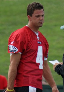 Kevin Kolb talks things over with a coach during training camp.