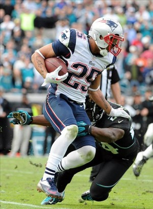 Dec 23, 2012; Jacksonville, FL, USA; New England Patriots safety Patrick Chung (25) runs back the ball after an interception as he is defended by Jacksonville Jaguars running back Montell Owens (24) during the second half of the game at EverBank Field. Mandatory Credit: Melina Vastola-USA TODAY Sports