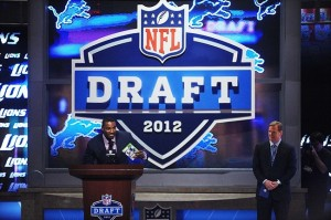 Apr 26, 2012; New York, NY, USA; Detroit Lions wide receiver Calvin Johnson (left) announces Iowa tackle Riley Reiff (not pictured) as the Lions 23rd overall selection as NFL commissioner Roger Goodell (right) looks on during the 2012 NFL Draft at Radio City Music Hall. Mandatory Credit: James Lang-USA TODAY Sports