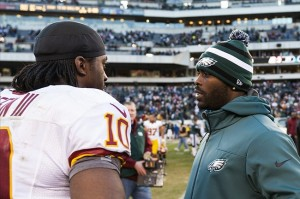 Dec 23, 2012; Philadelphia, PA, USA; Philadelphia Eagles quarterback Michael Vick (7) talks with Washington Redskins quarterback Robert Griffin III (10) after the game at Lincoln Financial Field. The Redskins defeated the Eagles 27-20. Mandatory Credit: Howard Smith-USA TODAY Sports