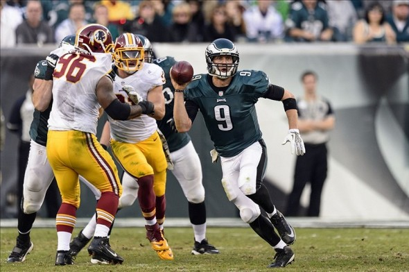 Nov 17, 2013; Philadelphia, PA, USA; Philadelphia Eagles quarterback Nick Foles (9) scrambles during the fourth quarter against the Washington Redskins at Lincoln Financial Field. The Eagles defeated the Redskins 24-16. Mandatory Credit: Howard Smith-USA TODAY Sports