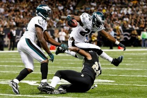 November 5, 2012; New Orleans, LA, USA; Philadelphia Eagles running back LeSean McCoy (25) leaps over New Orleans Saints cornerback Corey White (24) during the second half of a game at the Mercedes-Benz Superdome. The Saints defeated the Easgles 28-13. Mandatory Credit: Derick E. Hingle-USA TODAY Sports