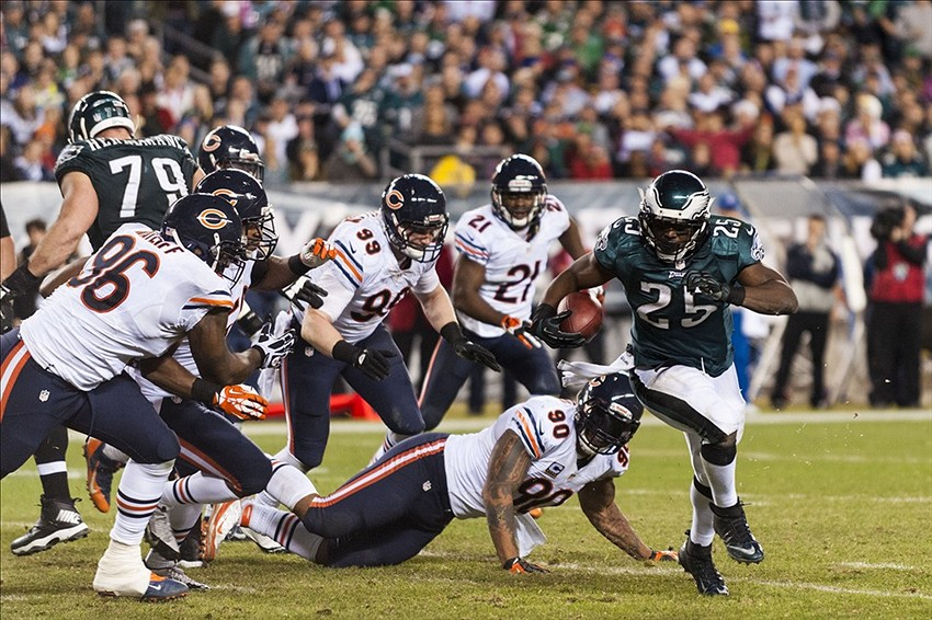 Dec 22, 2013; Philadelphia, PA, USA; Philadelphia Eagles running back LeSean McCoy (25) carries for a touchdown during the third quarter against the Chicago Bears at Lincoln Financial Field. Howard Smith-USA TODAY Sports