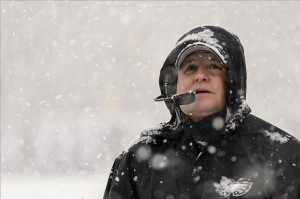 Dec 8, 2013; Philadelphia, PA, USA; Philadelphia Eagles head coach Chip Kelly watches as the snow falls during the first quarter against the Detroit Lions at Lincoln Financial Field. Mandatory Credit: Howard Smith-USA TODAY Sports