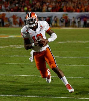Jan 3, 2014; Miami Gardens, FL, USA; Clemson Tigers quarterback Tajh Boyd (10) runs with the ball against the Ohio State Buckeyes in the second half of the 2014 Orange Bowl college football game at Sun Life Stadium. The Tigers won 40-35. Mandatory Credit: Robert Mayer-USA TODAY Sports