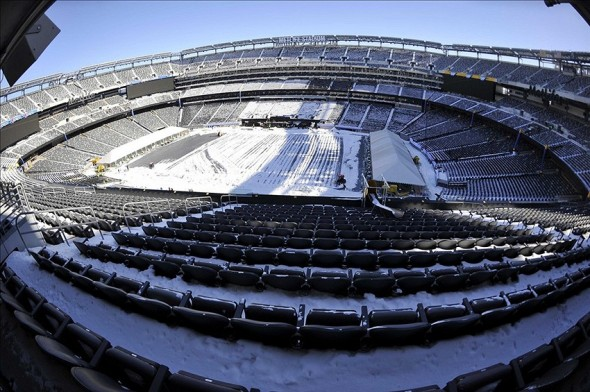 Jan 22, 2014; East Rutherford, NJ, USA; A general view as stadium workers clean snow from the field and stands during the Super Bowl XLVIII stadium preparations press conference at MetLife Stadium. Mandatory Credit: Joe Camporeale-USA TODAY Sports