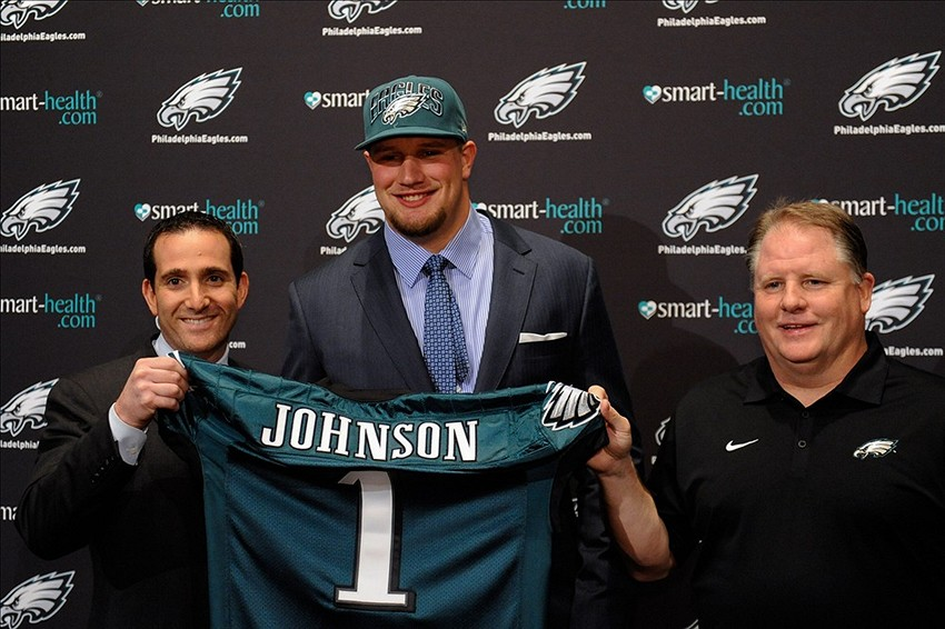 Apr 26, 2013; Philadelphia, PA, USA; Philadelphia Eagles general manager Howie Roseman offensive tackle Lane Johnsonwith (Oklahoma) the fourth overall pick of the 2013 NFL Draft and head coach Chip Kelly pose for a photo during a press conference at the NovaCare Complex. Mandatory Credit: Howard Smith-USA TODAY Sports
