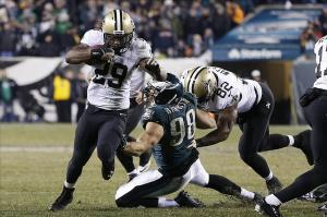 Jan 4, 2014; Philadelphia, PA, USA; New Orleans Saints running back Khiry Robinson (29) runs with the ball past Philadelphia Eagles outside linebacker Connor Barwin (98) in the fourth quarter during the 2013 NFC wild card playoff football game at Lincoln Financial Field. The Saints won 26-24. Mandatory Credit: Geoff Burke-USA TODAY Sports