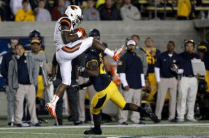 Oct 19, 2013; Berkeley, CA, USA; Oregon State Beavers wide receiver Brandin Cooks (7) catches the ball against California Golden Bears defensive back Damariay Drew (27) during the second quarter at Memorial Stadium. Mandatory Credit: Kelley L Cox-USA TODAY Sports